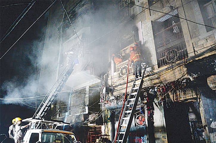 FIREFIGHTERS try to extinguish the fire that broke out in the Arambagh furniture market on Thursday  evening.—White Star