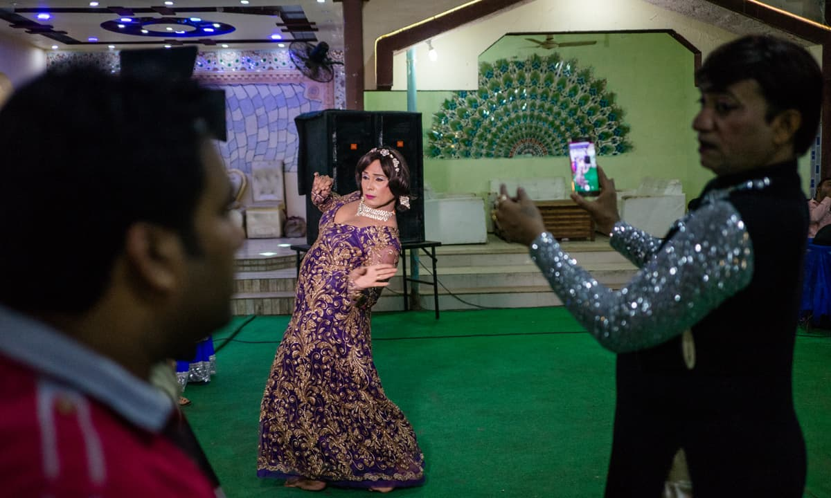A transgender person poses for a picture