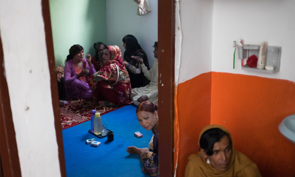 Members of  transgender community smoking cigarettes in their guru's house