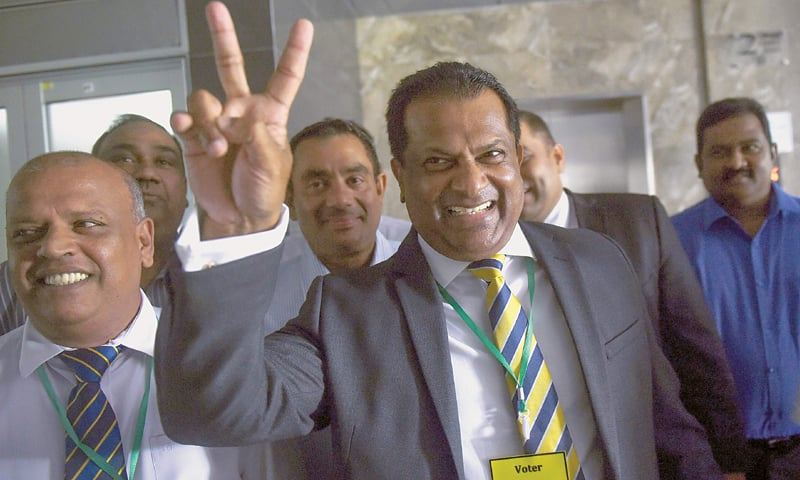 NEWLY-ELECTED Sri Lanka Cricket president Shammi Silva gestures as he leaves after a press conference on Thursday. —AFP