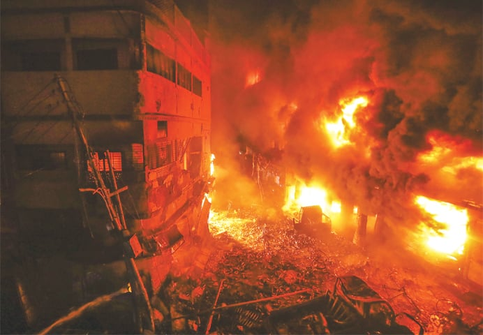 Flames and smoke rise from the fire that tore through buildings in Dhaka.—AP