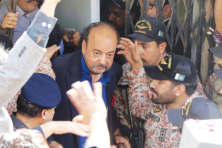 KARACHI: Agha Siraj Durrani coming out of the NAB court which granted his physical remand until March 1 on Thursday. The Sindh Assembly Speaker was taken into custody by NAB when he was on a visit to Islamabad on Wednesday.—Online