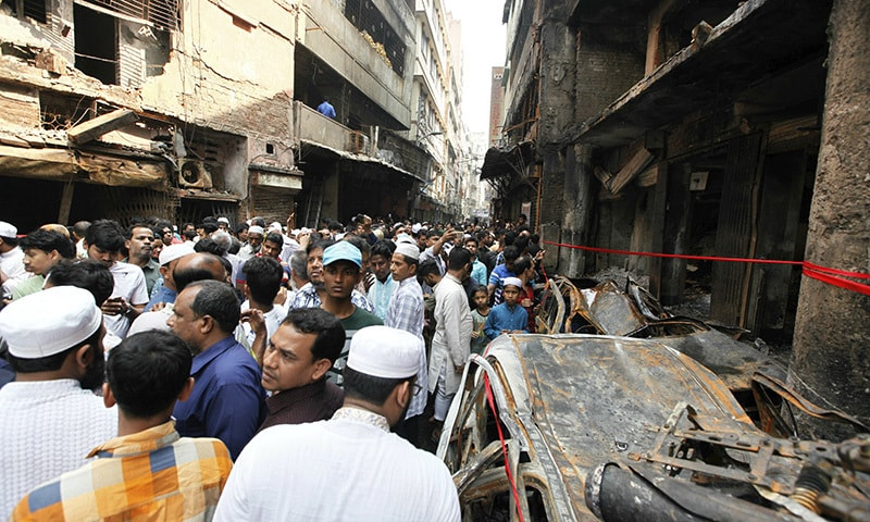 A crowd gathers at the site of Wednesday night's fire in Dhaka, Bangladesh. — AP