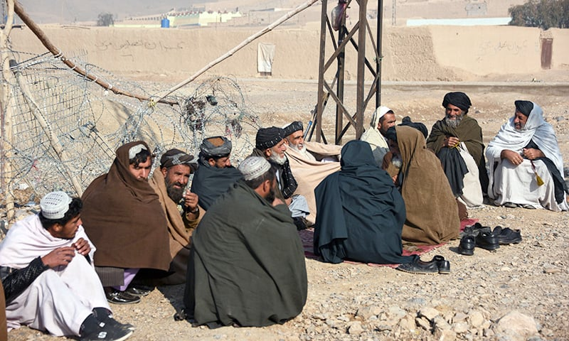In this photo taken on February 9, 2019, internally displaced Afghan men talk in Kandahar city, after fleeing conflict with the Taliban in the Deh Rawood district of Uruzgan province. —AFP