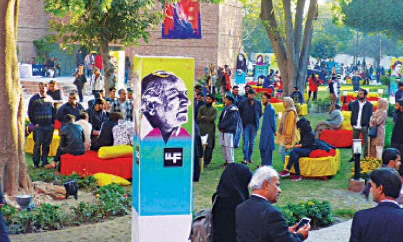 PEOPLE gather on the lawns of the Alhamra on the first day of the seventh edition of the Lahore Literary Festival. — White Star