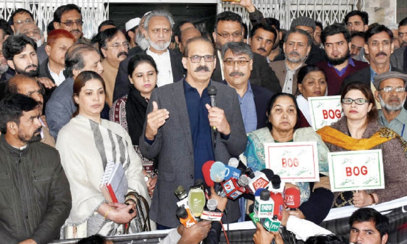 Minister for National Health Services Aamer Mehmood Kiani speaks to protesters at Pims on Friday. — INP