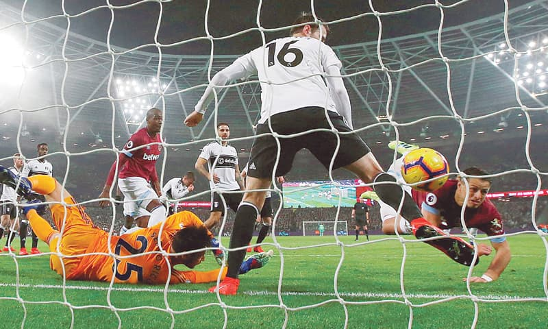 LONDON: West Ham's Javier Hernandez (R) scores during the Premier League match against Fulham at the London Stadium. — Reuters