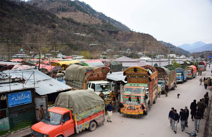 In this picture taken on Feb 20, goods trucks are pictured at the border town of Chakothi in Azad Kashmir, some 3 km from Line of Control (LoC). Following the Pulwama attack, India revoked MFN status to Pakistan and slammed 200 per cent import duty on imports—AFP