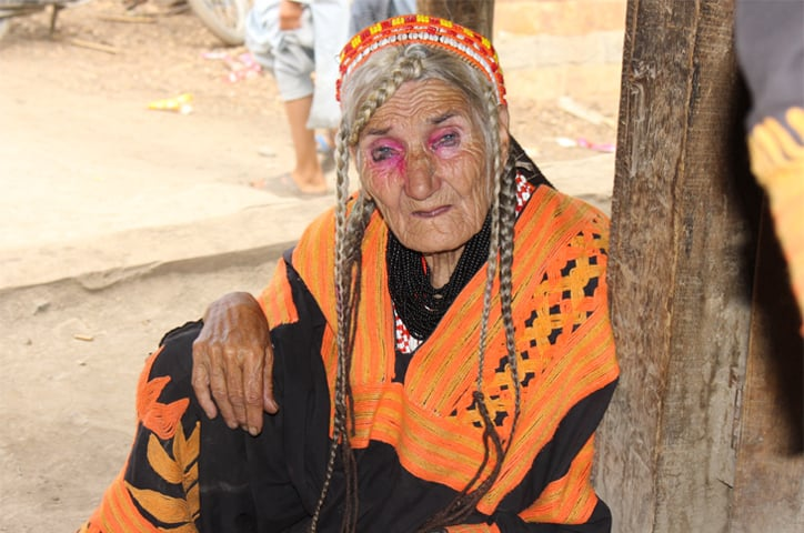 Elders such as this woman have seen their younger generations take little interest in their culture and customs