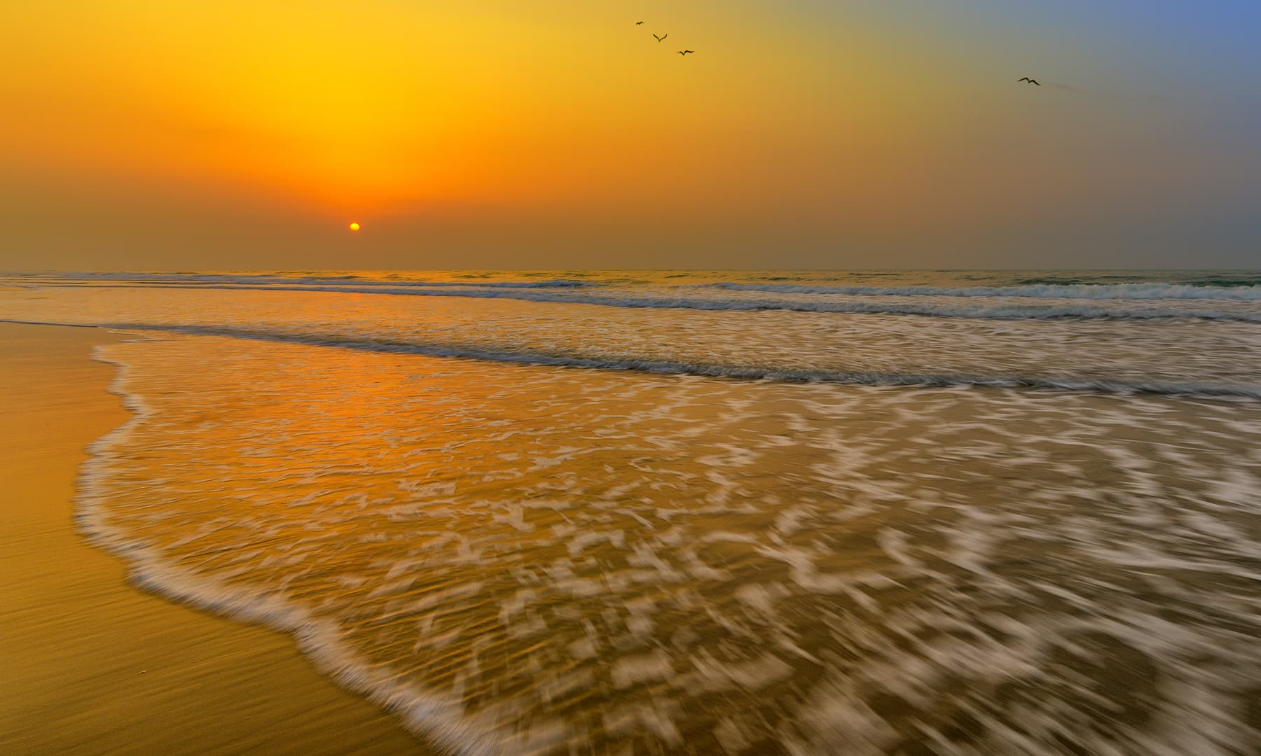 An exhibition of sunrise over the coast of Kund Malir - Syed Mehdi Bukhari