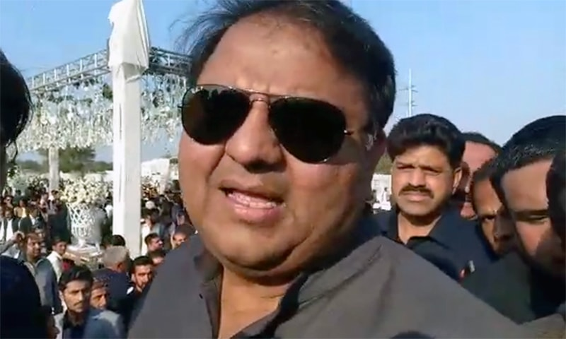 Information Minister Fawad Chaudhry speaks to reporters in Jhelum on Sunday. — Screengrab