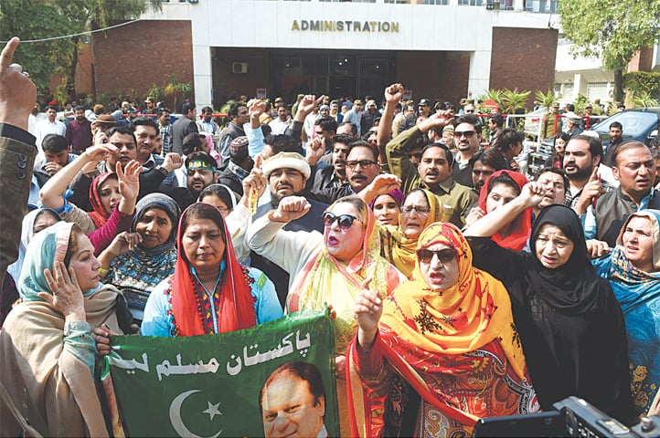 SUPPORTERS of former prime minister Nawaz Sharif shout slogans outside Jinnah Hospital Lahore after the Islamabad High Court rejected a petition seeking release of their leader on bail on medical grounds.—M. Arif / White Star