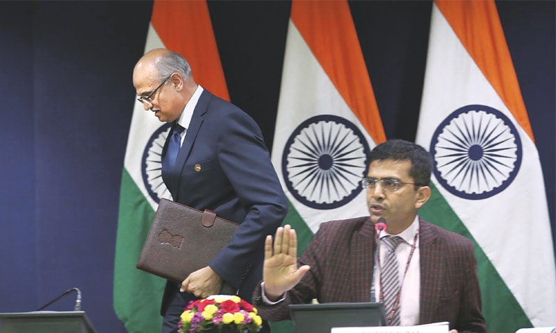 NEW DELHI: India's foreign ministry spokesperson Raveesh Kumar (right) refuses to entertain questions as foreign secretary Vijay Gokhale leaves the room on Tuesday after briefing the media about the Indian Air Force action inside Pakistani territory.—AP