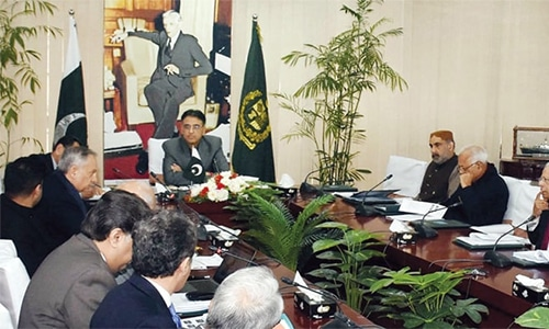 Finance Minister Asad Umar chairs an Economic Coordination Committee meeting. — Dawn