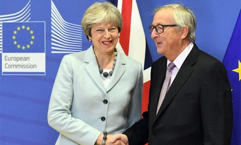 British Prime Minister Theresa May meets European Commission President Jean-Claude Juncker.—AFP/File