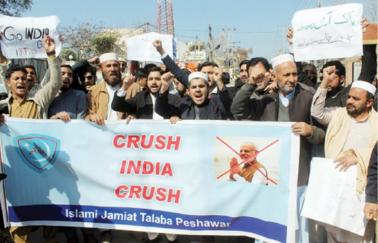 Activists of Islami Jamiat Talaba stage an anti-India protest in Peshawar on Wednesday. — INP