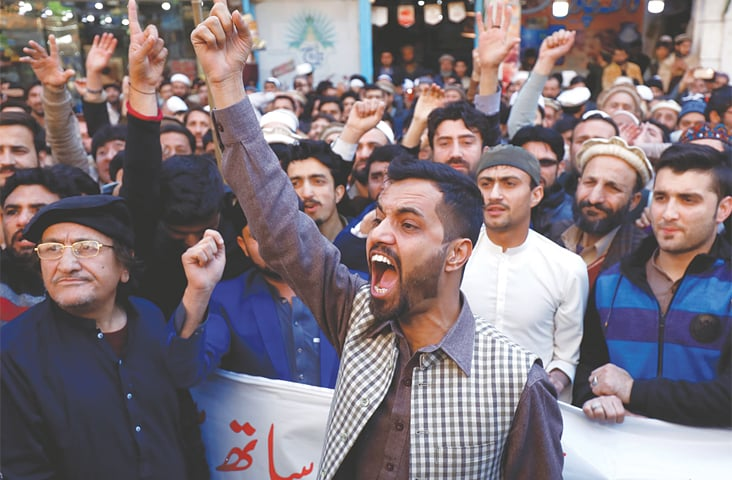 PESHAWAR: People chant slogans in support of the armed forces during a rally on Wednesday.—Reuters