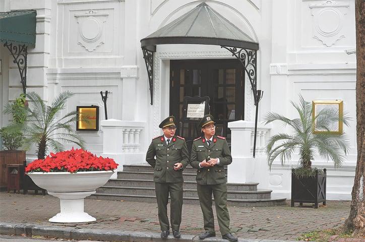 HANOI: Vietnamese police outside the French colonial-era Sofitel Legend Metropole Hotel.—Reuters