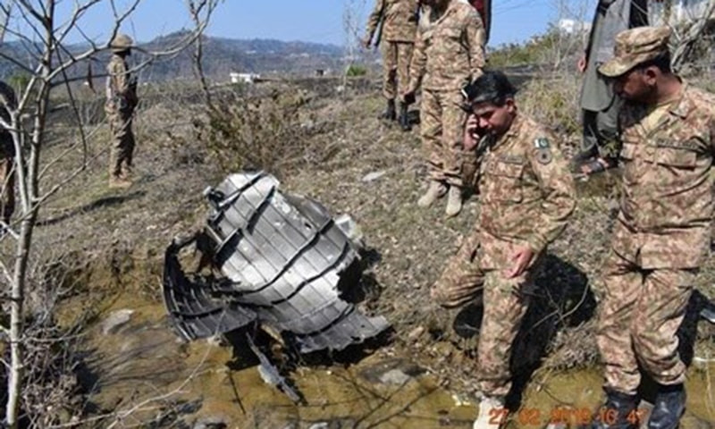 Soldiers stand near the wreckage of an aircraft after it was shot down by Pakistan Air Force.—ISPR