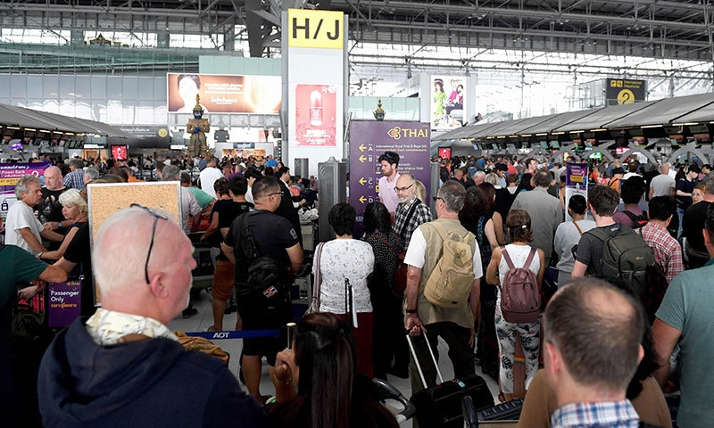 Stranded passengers wait at the check-in area at the Suvarnabhumi International Airport in Bangkok on February 28. — AFP