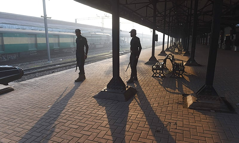 Policemen stand guard at Lahore railway station on February 28. ─ AFP
