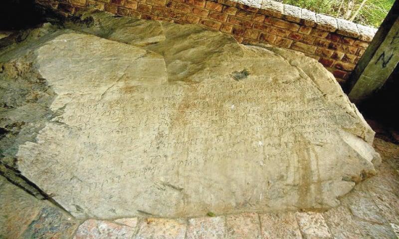 (TOP) A Budhist monastry in Aziz Dheri and (above) Ashoka rock edicts in Shahbaz Garhi, Mardan. — Dawn