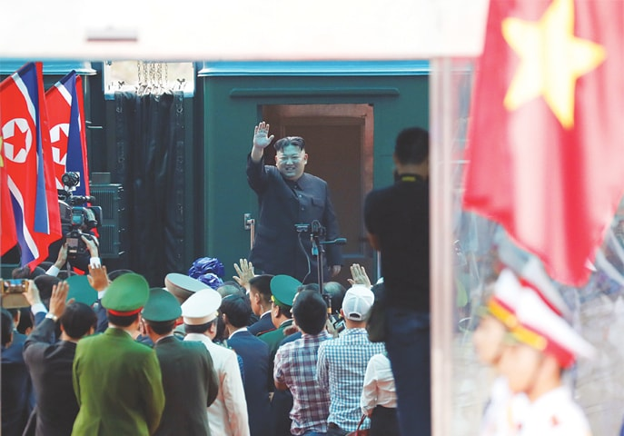 North Korean leader Kim Jong Un bids farewell to the crowd before boarding his train to depart for North Korea at Dong Dang railway station in Vietnam on Saturday.—Reuters