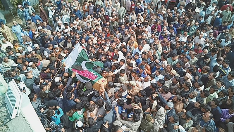 People carry the coffin of Shakirullah for burial at Daska on Sunday.—Dawn