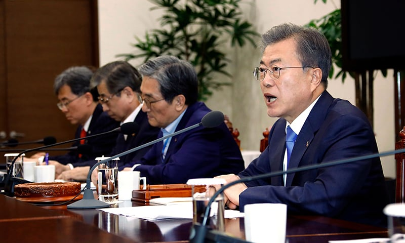 South Korean President Moon Jae-In (R) presides over a meeting of the National Security Council at the presidential Blue House in Seoul on March 4, 2019. — AFP