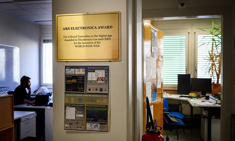 A plaque is displayed next to the former office of the inventor of the World Wide Web Tim Berners-Lee (on the right) at the European Organisation for Nuclear Research (CERN). — AFP