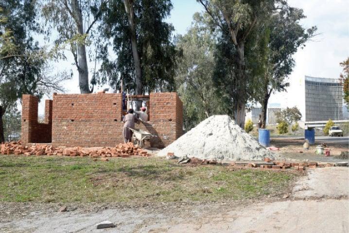The under-construction traffic police's room on a greenbelt near Zero Point along Islamabad Expressway. — White Star
