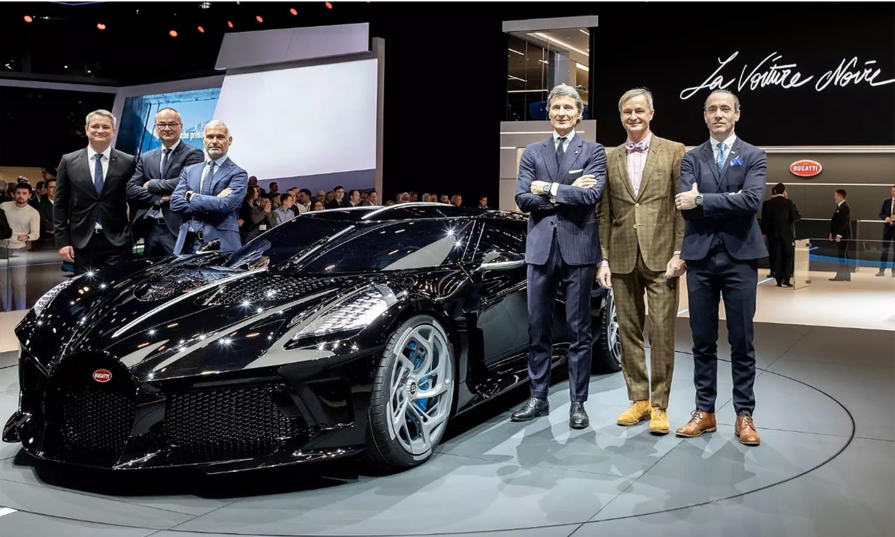 Bugatti executives unveil the La Voiture Noire, the world's most expensive new car, at the Geneva auto show in Geneva, Switzerland. — Photo: Bugatti.com