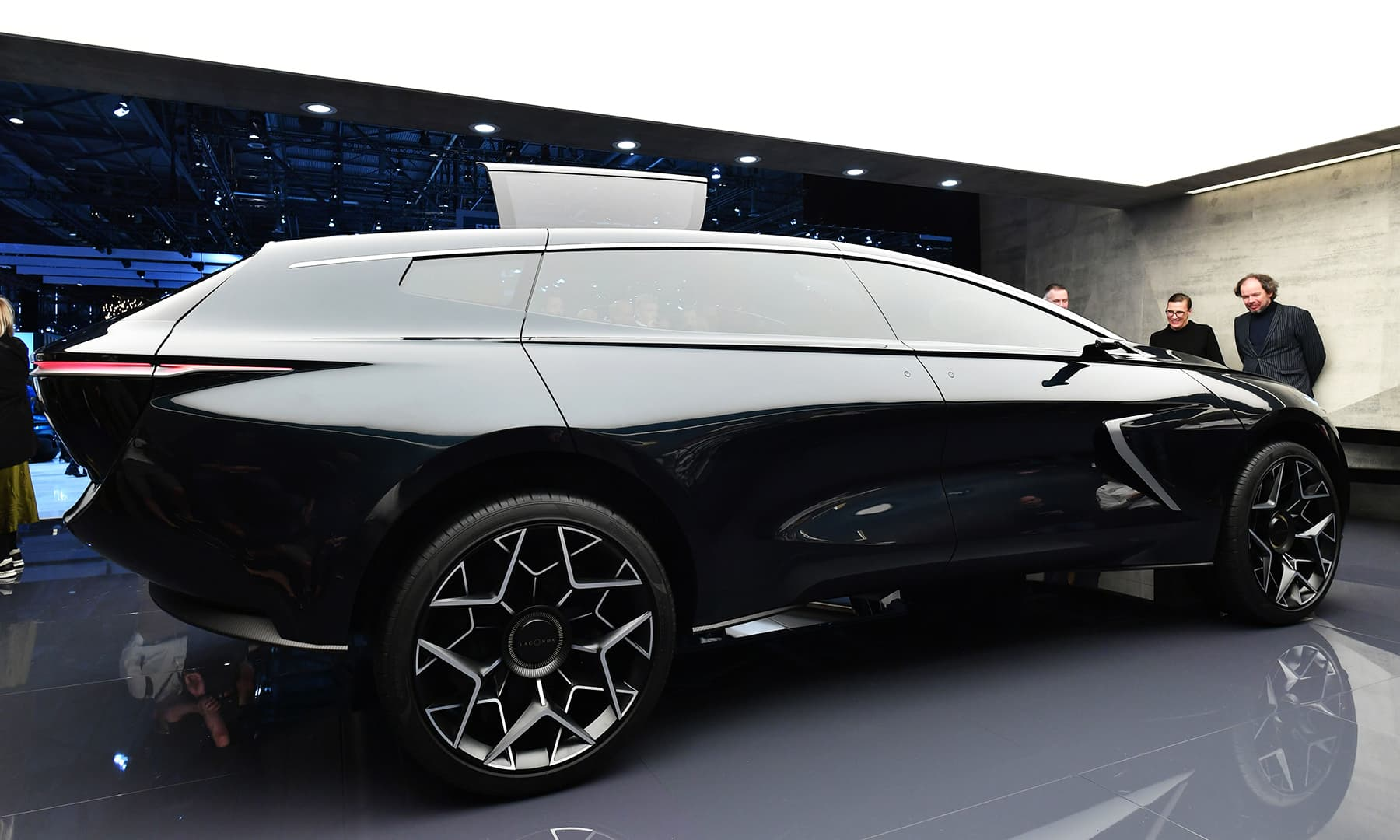 Visitors look at a Aston Martin Lagonda car on March 5 during a press day ahead of the 2019 edition of the Geneva International Motor Show. — AFP