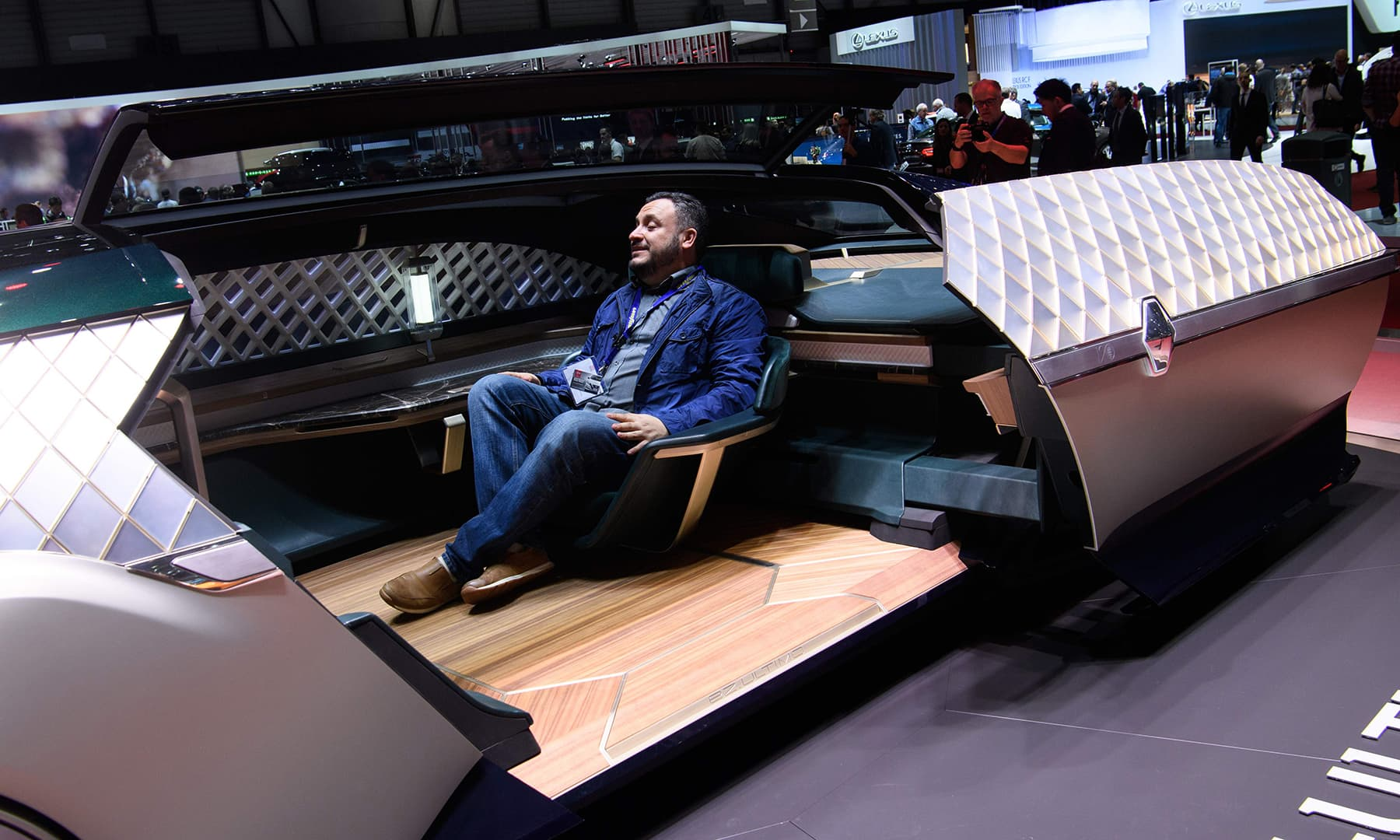 A visitor sits in the Renault EZ-ULTIMO concept car in Geneva. — AFP