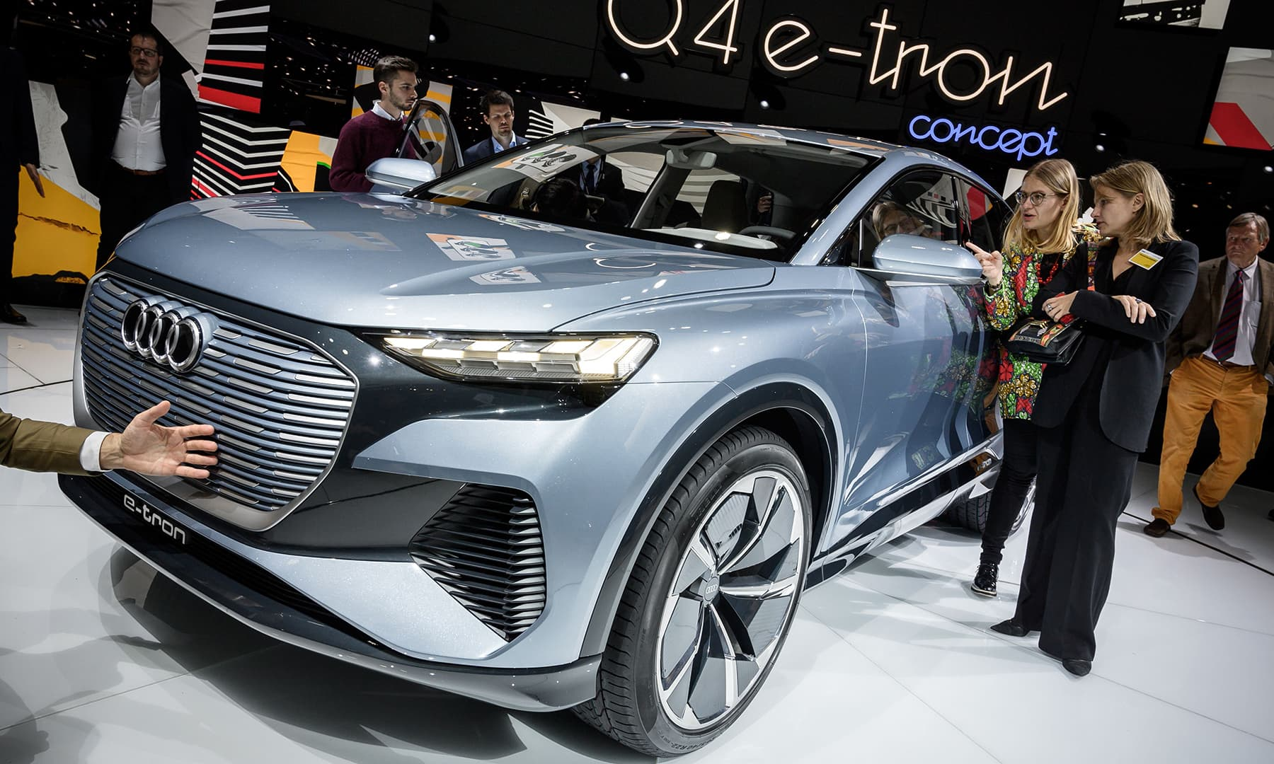 A new Audi Q4 e-tron model car is seen at the booth of the German carmaker during a press day ahead of the Geneva auto show. — AFP