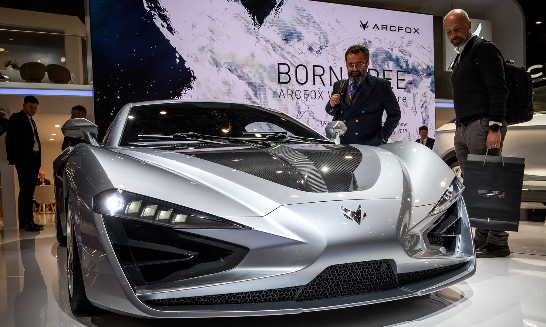 Visitors look at the Arcfox-GT model car at the booth of the Chinese carmaker on March 5 ahead of the Geneva International Motor Show. — AFP
