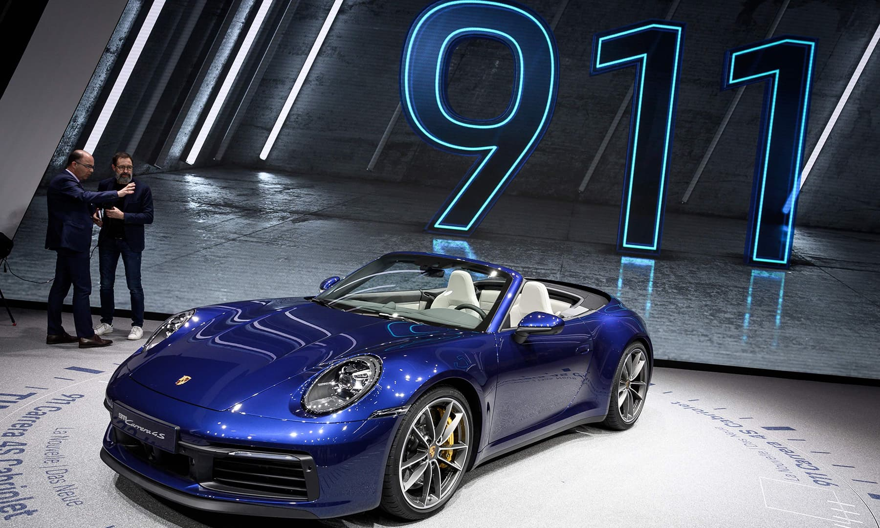 The new Porsche 911 Cabriolet model car is seen at the booth of the German carmaker ahead of the Geneva International Motor Show. — AFP