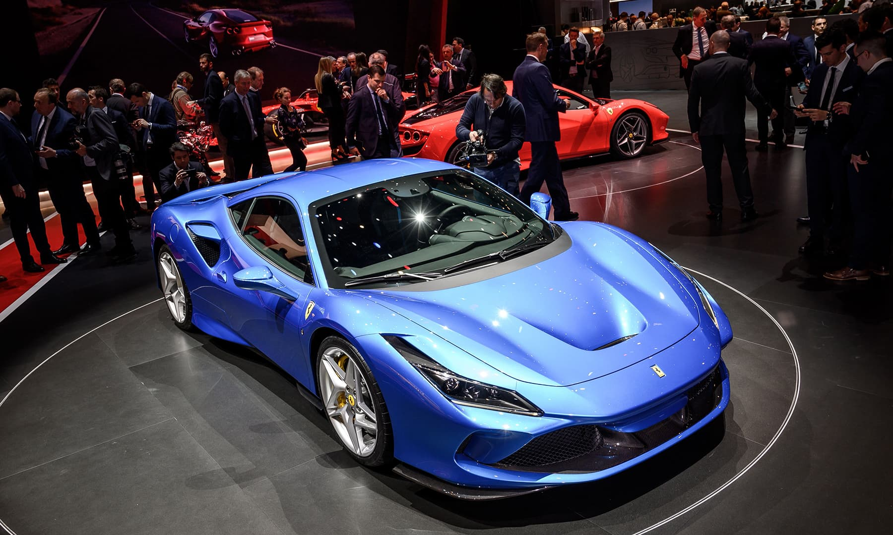 The new Ferrari F8 Tributo is displayed at the booth of the Italian carmaker on March 5 during a press day ahead of the Geneva International Motor Show. — AFP