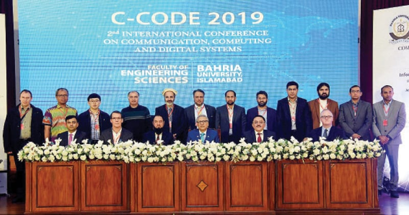 President Dr Arif Alvi poses for a photograph with participants of the 2nd International Conference on Communication, Computing and Digital Systems on Wednesday. — APP