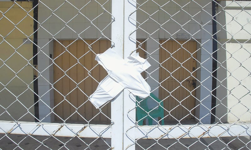ISLAMABAD: The gate of an educational institution run by Jamaatud Dawa in Islamabad's I-8 area is seen sealed. —Tanveer Shahzad / White Star