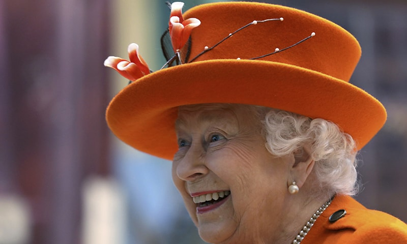 Britain's Queen Elizabeth II reacts during a visit to the Science Museum in London on Thursday. — AP