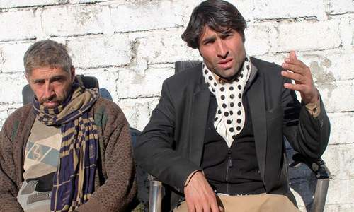 """Afzal Kohistani (right) is pictured on January 27, 2019, describing his fears to journalists that he might be killed on a jirga's orders for """"defaming"""" the people of Kohistan. — Photo by Umar  Bacha"""