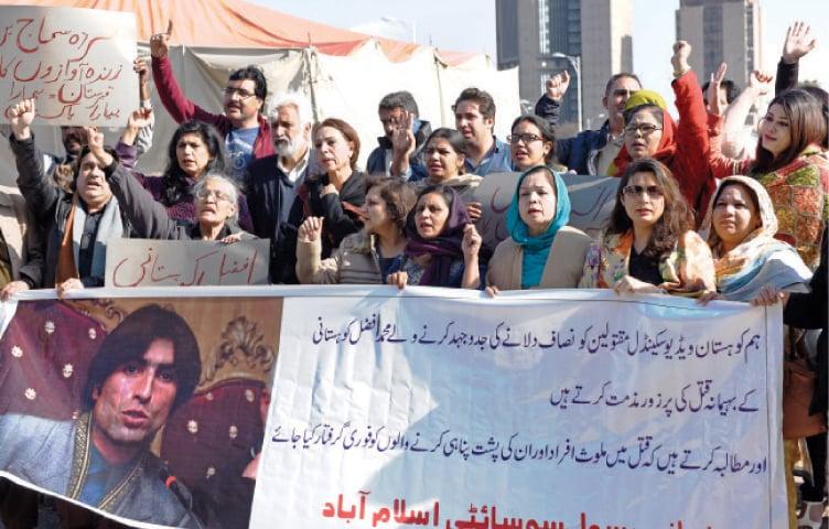 Civil society activists protest the killing of Mohammad Afzal Kohistani outside the NPC on Thursday. — White Star