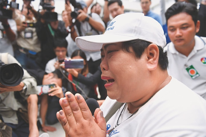 Bangkok: A supporter of the Thai Raksa Chart party reacts after the ruling.—AFP