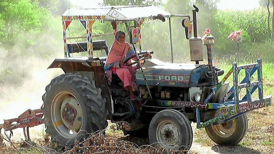Perween on her tractor is a familiar sight in her village. — Photo courtesy, Reed Society