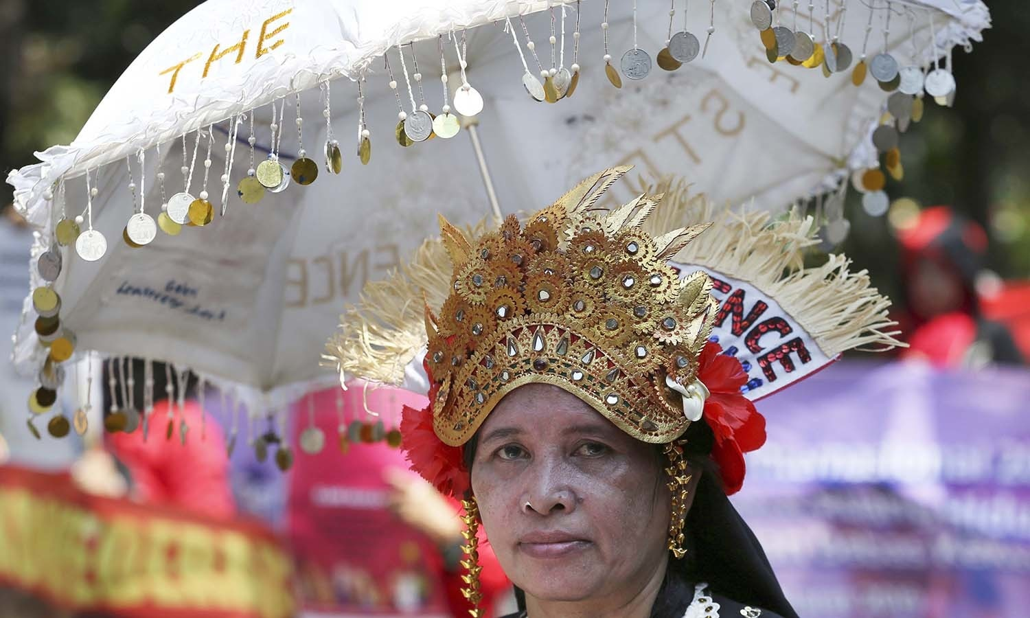 An activist marks International Women's Day during a rally near Merdeka palace in Jakarta, Indonesia. — AP