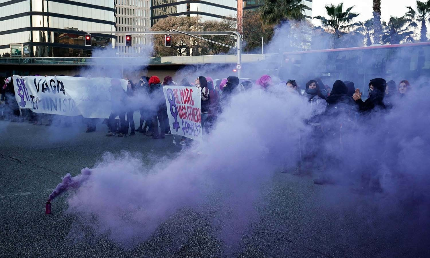 Demonstrators block the Gran Via street during a protest marking International Women's Day in Barcelona on Friday. — AFP