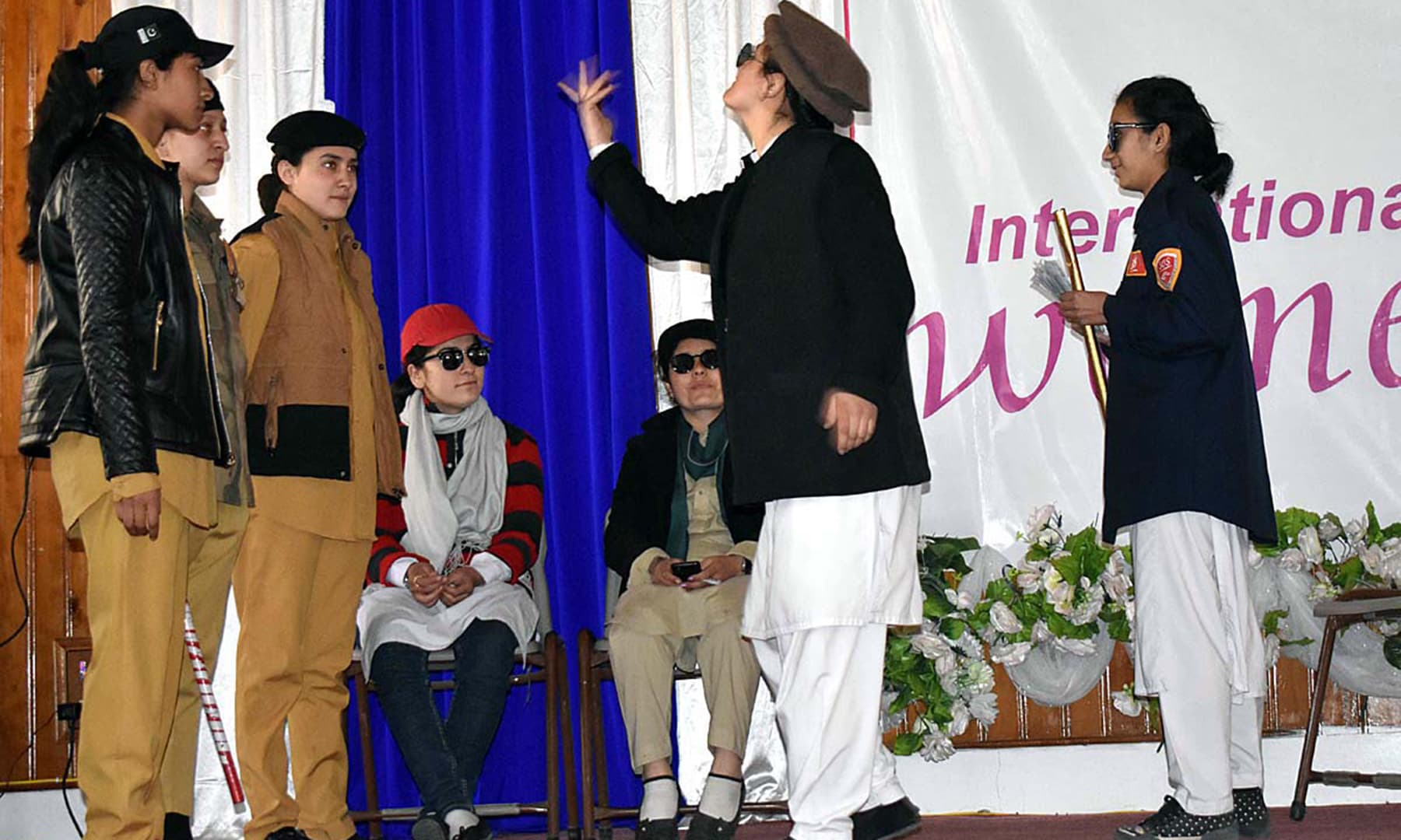 Students perform in a tableau during a function to mark International Women's Day at Women's Degree College Organi in Gilgit. — APP