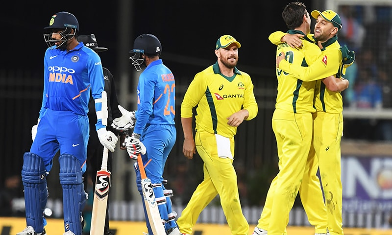 Australian cricket captain Aaron Finch (C) celebrates with teammates the team's win during the third ODI between India and Australia at the Jharkhand State Cricket Association International Cricket Stadium, in Ranchi on Friday. — AFP