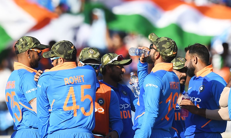 Indian cricket team members are seen wearing camouflage army caps during the third ODI match between India and Australia at the Jharkhand State Cricket Association International Cricket Stadium, in Ranchi on Friday. — AFP